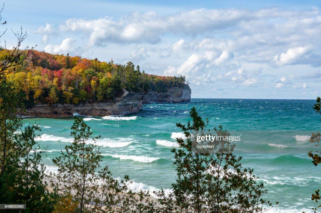 Crashing Waves and Autumn Trees on Lake Superior Shore, Michigan : Stock Photo