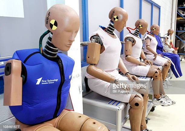Crashtest dummies are displayed at Takata's current crashtesting facility August 19 2010 in Auburn Hills Michigan Takata dedicated a new hightech...