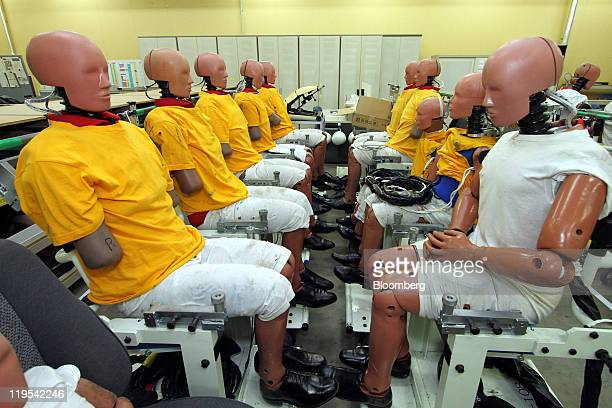 Crash-test dummies are displayed ready for tests at Toyota Motor Corp's Higashifuji Technical Center in Susono city, Shizuoka prefecture, Japan, on...