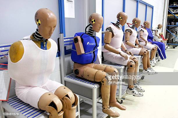 Crashtest dummies representing humans of various ages and body weights are displayed at Takata's current crashtesting facility August 19 2010 in...