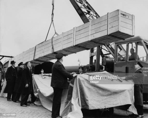 A crate containing a roll of carpet is unloaded at St Pancras goods yard London in preparation for the coronation of Queen Elizabeth II 29th April...