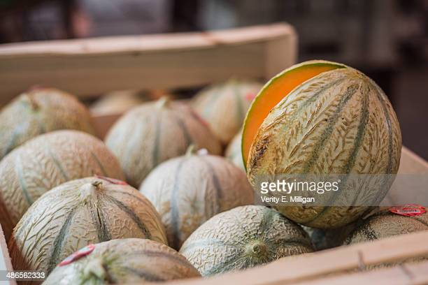 crate of cantaloupe melons at market - charente stock pictures, royalty-free photos & images