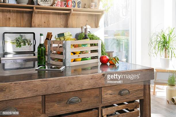 Crate of groceries in country style kitchen