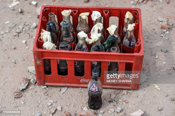 TOPSHOT A crate of Molotov cocktails is seen in the premises of Aam Admin Party councillor Tahir Hussain at the riothit area following clashes...