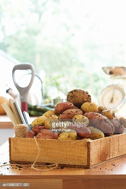 Crate of potatoes on kitchen counter