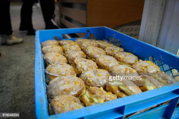 A crate with fresh paczki or Polish donuts is seen in Tlusty Czwartek on February 8 2018 Tlusty Czwartek or Fat Thursday is the last Thursday before...
