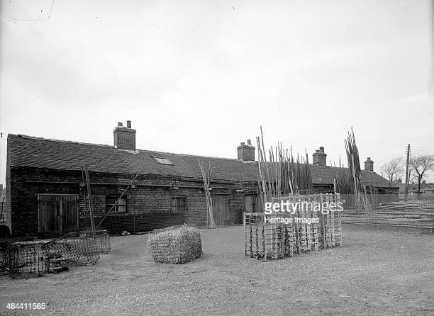 Cratemakers' workshops Greenfields Pottery Tunstall StokeonTrent Staffordshire 1960 A row of outbuildings with piles of wood leaning up against the...