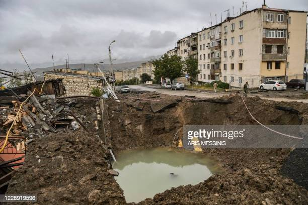 Crater caused by a shell explosion is pictured in the breakaway Nagorno-Karabakh region's main city of Stepanakert on October 6 during the ongoing...