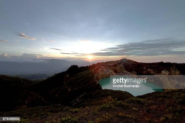 crater lake at dawn, flores, east nusa tenggara, indonesia - east nusa tenggara stock pictures, royalty-free photos & images