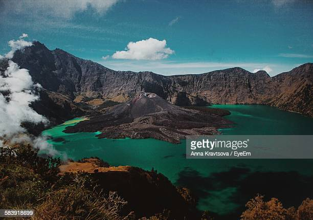 Crater Lake At Mount Rinjani Against Sky