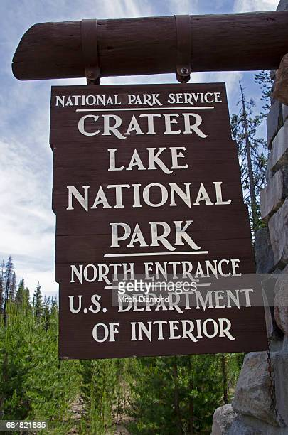 crater lake national park sign - medford oregon stock photos and pictures