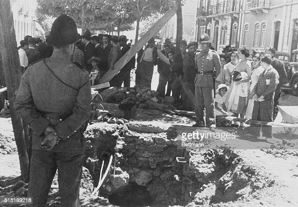 'Crater' left by bomb aimed at Portuguese dictatorPolice standing guard over the twelvefoot 'crater' torn in a Lisbon street recently by the...