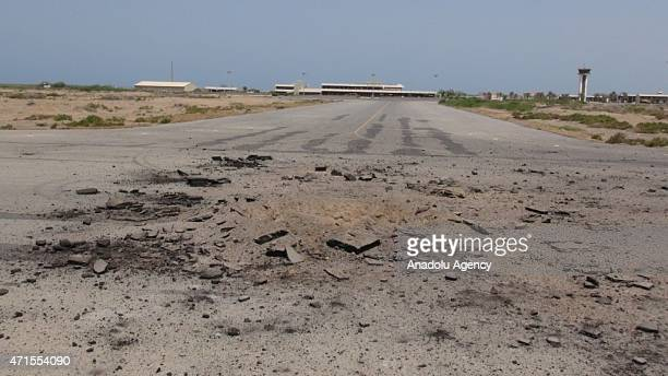 A crater left by the air attacks of Saudiled coalition seen at Hodeidah International Airport in Hodeidah Yemen on April 29 2015