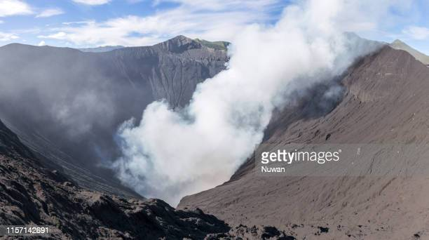 crater of active mt. bromo volcano in java, indonesia - caldera stock pictures, royalty-free photos & images