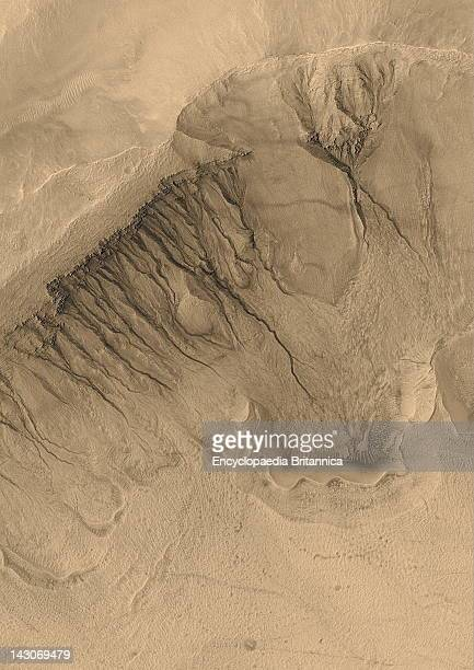 Crater On Mars Gullies Line The Steep Wall Of A Crater In Newton Basin In Sirenum Terra On Mars In An Image Taken By Mars Global Surveyor The Gullies...