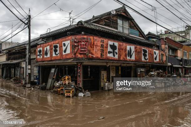 Crates and salvaged property stand outside a flood damaged restaurant after the nearby Kuma River burst its banks, on July 5, 2020 in Hitoyoshi,...
