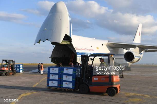 Crates containing humanitarian aid are loaded onto an Antonov An124 Ruslan Widebody at the former ChateaurouxDeols Marcel Dassault Airport in central...