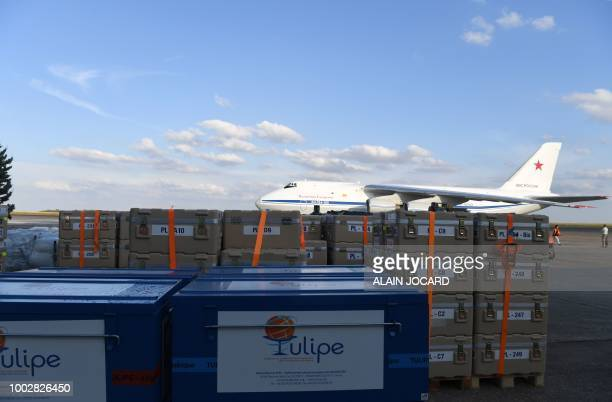 Crates containing humanitarian aid sit on the tarmac before being loaded onto an Antonov An124 Ruslan Widebody at the former ChateaurouxDeols Marcel...