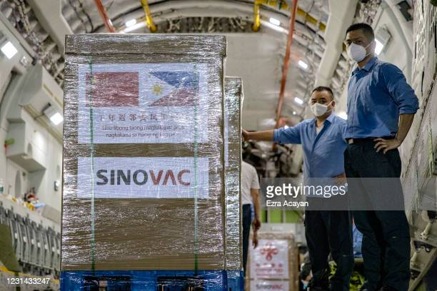 Crates containing Sinovac Biotech COVID-19 vaccines are unloaded from a Chinese Airforce plane upon arriving at Ninoy Aquino International Airport on...