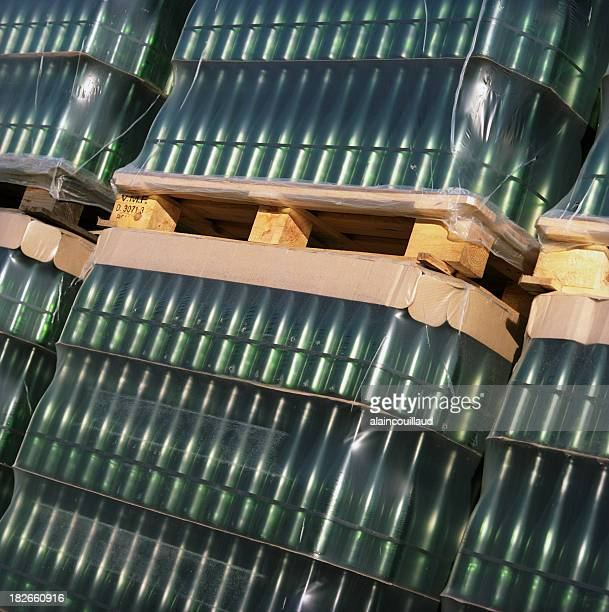 Crates filled with empty wine bottles