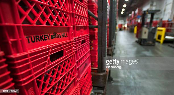 Crates of beverages sit in the fluid warehouse at Turkey Hill LP's production facility in Contestoga Pennsylvania US on Monday Nov 21 2011 Turkey...