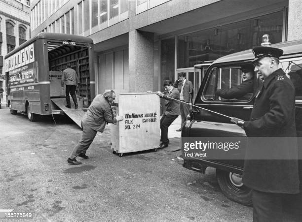 Crates of criminal records are moved into the new premises of New Scotland Yard the headquarters of the Metropolitan Police Service on Victoria...