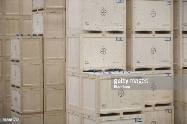 Crates of rapeseed stand stacked inside the Bayer CropScience AG processing facility in Monheim Germany on Wednesday March 21 2018 Bayer cleared one...