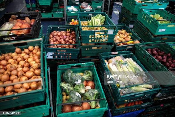Crates of surplus food collected from supermarkets sit stacked at foodwaste charity The Felix Project's warehouse in Park Royal on February 27 2019...