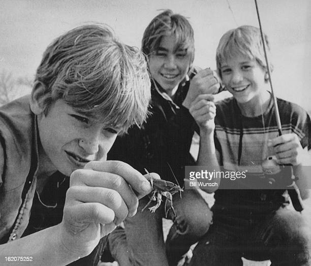 MAR 26 1986 Crawdads and a favorite fishing hole brought 8th graders Jason MacKay Patrick and Tait Hanson for a day of fishing at prospect lake in...