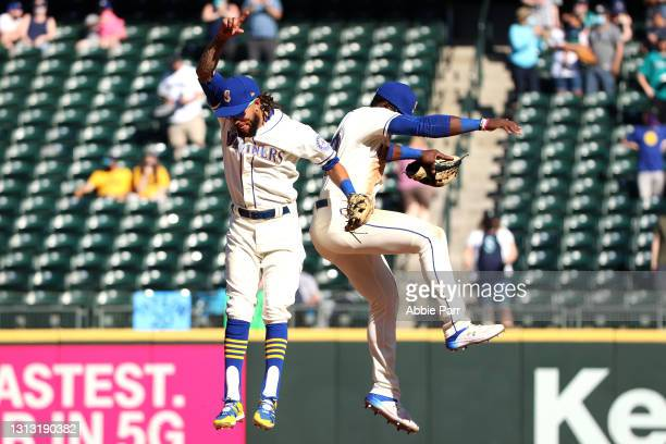 Crawford and Taylor Trammell of the Seattle Mariners celebrate after defeating the Houston Astros 7-2 at T-Mobile Park on April 18, 2021 in Seattle,...