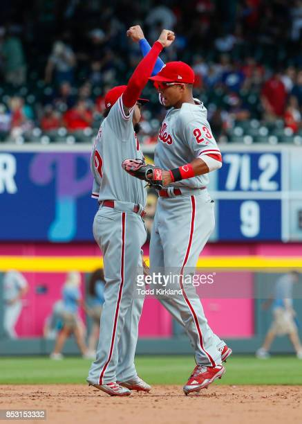 P Crawford of the Philadelphia Phillies and Aaron Altherr react at the conclusion an MLB game against the Atlanta Braves at SunTrust Park on...
