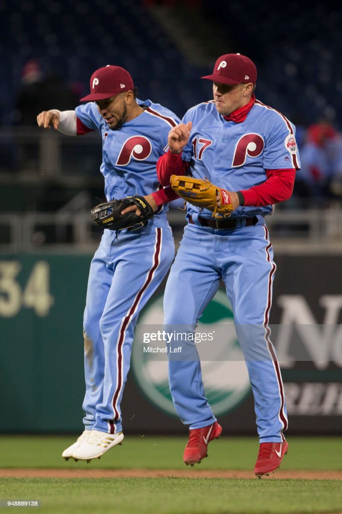 J.P. Crawford #2 of the Philadelphia Phillies celebrates with Rhys Hoskins #17 after the game against the Pittsburgh Pirates at Citizens Bank Park on April 19, 2018 in Philadelphia, Pennsylvania. The Phillies defeated the Pirates 7-0.