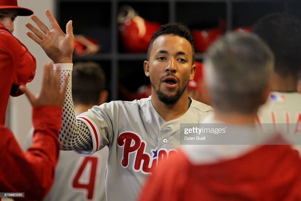 J.P. Crawford #2 of the Philadelphia Phillies celebrates with teammates after scoring a run in the sixth inning against the Milwaukee Brewers at Miller Park on June 15, 2018 in Milwaukee, Wisconsin.