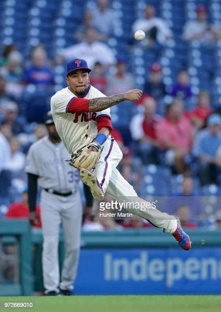 P Crawford of the Philadelphia Phillies commits a throwing error after fielding a ground ball in the first inning during a game against the Colorado...