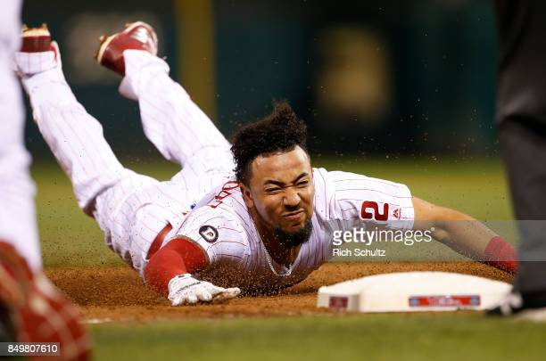 Crawford of the Philadelphia Phillies dives into third base with a triple during the seventh inning of a game against the Los Angeles Dodgers at...