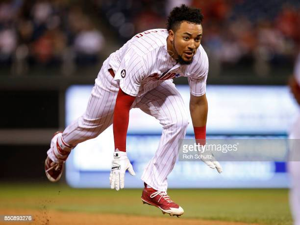 P Crawford of the Philadelphia Phillies dives into third base with a triple during the seventh inning of a game against the Los Angeles Dodgers at...