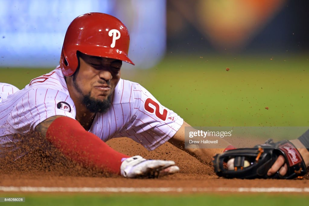 J.P. Crawford #2 of the Philadelphia Phillies gets tagged out sliding into third base in the sixth inning against the Miami Marlins at Citizens Bank Park on September 12, 2017 in Philadelphia, Pennsylvania. The Phillies won 9-8.