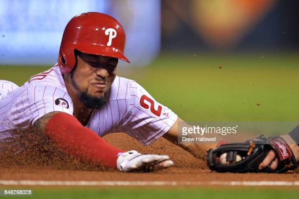 P Crawford of the Philadelphia Phillies gets tagged out sliding into third base in the sixth inning against the Miami Marlins at Citizens Bank Park...