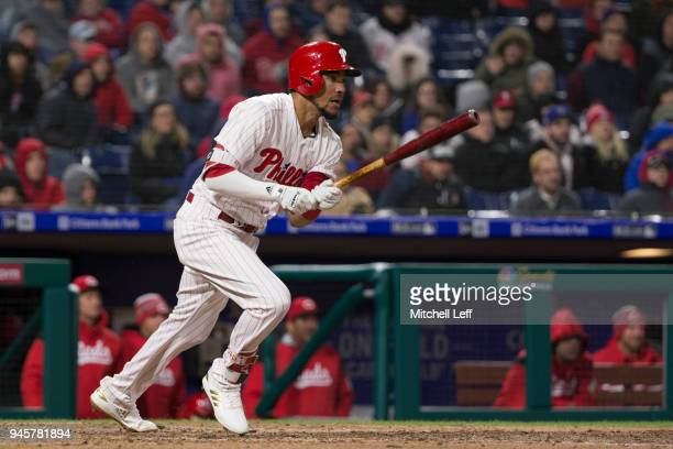 P Crawford of the Philadelphia Phillies hits an RBI single in the bottom of the seventh inning against the Cincinnati Reds at Citizens Bank Park on...