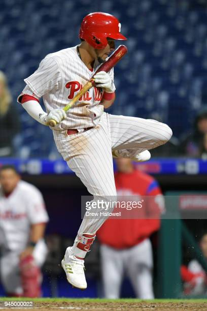 P Crawford of the Philadelphia Phillies jumps out of the way of an inside pitch in the 12th inning against the Cincinnati Reds at Citizens Bank Park...