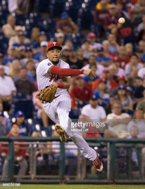 P Crawford of the Philadelphia Phillies throws out Yasiel Puig of the Los Angeles Dodgers in the top of the eighth inning at Citizens Bank Park on...