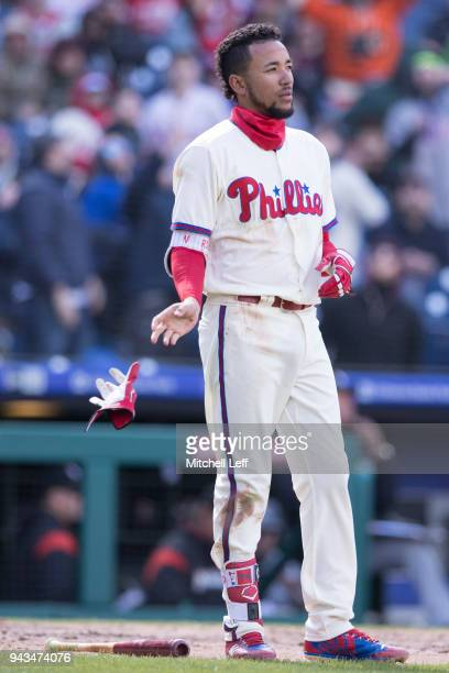 P Crawford of the Philadelphia Phillies tosses his batting glove after striking out in the bottom of the sixth inning against the Miami Marlins at...
