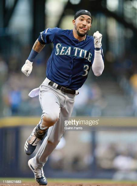 P Crawford of the Seattle Mariners advances to third base after hitting a RBI triple in the second inning against the Milwaukee Brewers at Miller...