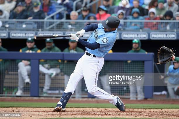 Crawford of the Seattle Mariners bats against the Oakland Athletics during the MLB spring training game at Peoria Stadium on February 22, 2019 in...