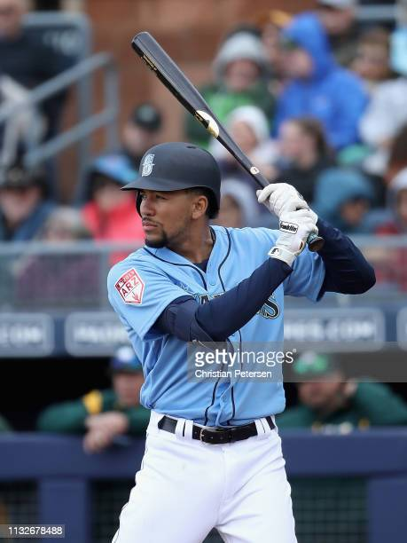 P Crawford of the Seattle Mariners bats against the Oakland Athletics during the MLB spring training game at Peoria Stadium on February 22 2019 in...