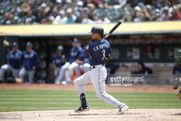 P Crawford of the Seattle Mariners bats during the game against the Oakland Athletics at the OaklandAlameda County Coliseum on May 26 2019 in Oakland...