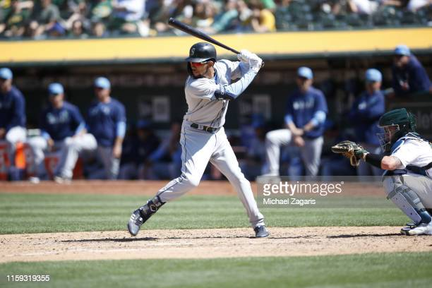 P Crawford of the Seattle Mariners bats during the game against the Oakland Athletics at the OaklandAlameda County Coliseum on June 16 2019 in...