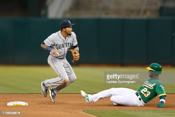 P Crawford of the Seattle Mariners gets the out at second base of Jurickson Profar of the Oakland Athletics and turns a double play in the bottom of...