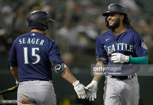 Crawford of the Seattle Mariners is congratulated by Kyle Seager after Crawford hit a solo home run against the Oakland Athletics in the top of the...