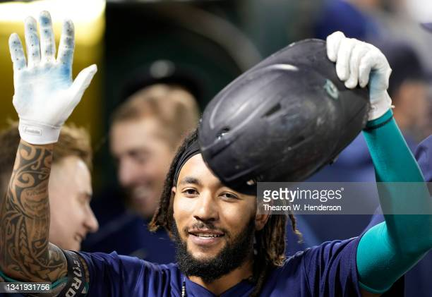 Crawford of the Seattle Mariners is congratulated by teammates after he hit a solo home run against the Oakland Athletics in the top of the ninth...